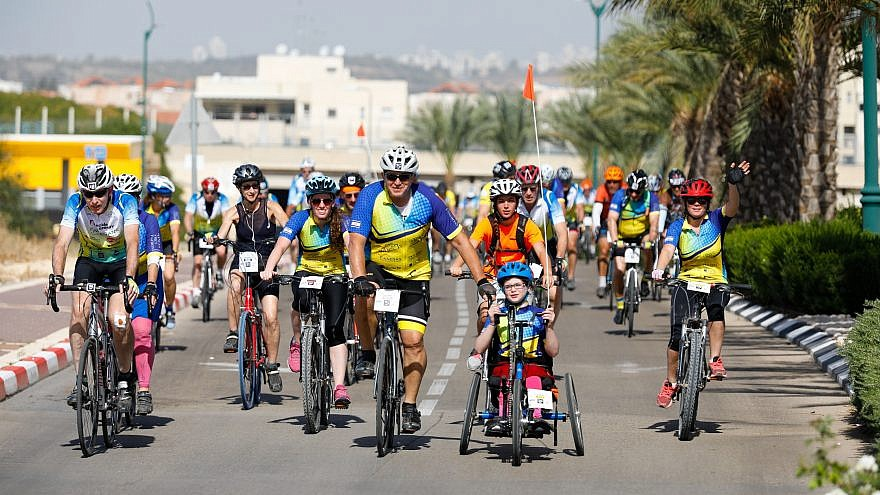 "Adults and kids participate in the ""Wheels of Love"" annual bike race in Israel. Credit: Tomer Feder Sport Photography."