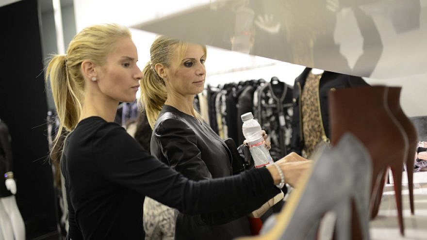 Israelis seen shopping during the first Tel Aviv Fashion Night at Kikar Hamedina in central Tel Aviv on Oct. 24, 2013. Many of the high society stores around the square offered their merchandise to much lower prices. Photo by Tomer Neuberg/Flash90.