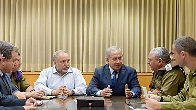 Israeli Prime Minister Benjamin Netanyahu holds a security consultation in Tel Aviv after the barrage of rocket fire from Hamas in Gaza.  Credit: GPO/Amos Ben-Gershom.