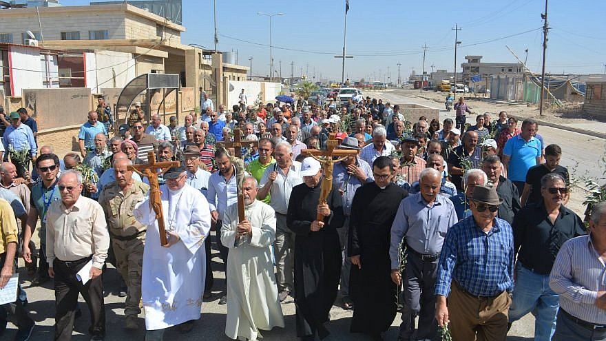 Iraqi Christians hold a procession in the Christian village of Qaraqosh in northern Iraq. Credit: Aid to the Church in Need.