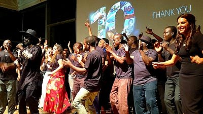 Innovation: Africa founder Sivan Yaari dances on stage with her organization's employees and volunteers at the Peres Center for Peace and Innovation. Credit: Courtesy.