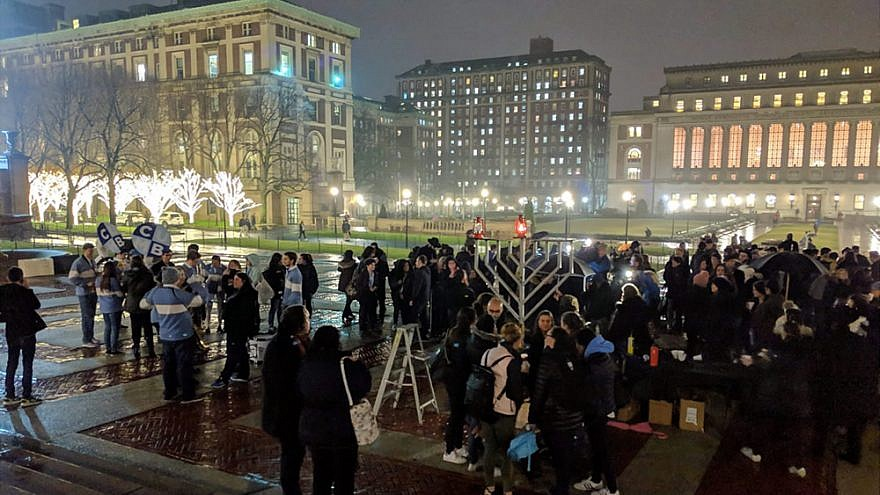Members of the Columbia University community gather on Sunday at the public menorah-lighting, organized by Chabad at Columbia University outside Low Memorial Library, on the first night of Hanukkah, Dec. 2, 2018. Photo by Jonathan Harounoff.