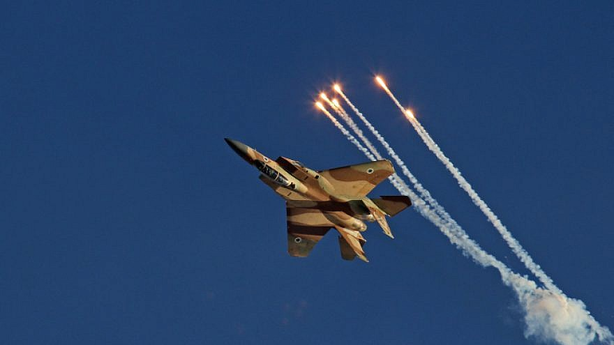 Aerobatic display of the F-15I fighter jet named as Ra'am, Hebrew for Thunder, during the IAF (Israeli army Air Force) flight course 166 graduation ceremony in the Hatzerim Air Base in the Negev Desert on June 23, 2013. Photo by Ofer Zidon/Flash90.