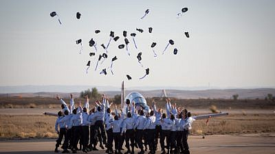Air Force pilots throw their hats in the air in celebration at a graduation ceremony for soldiers who have completed the official IAF flight course (Hatzerim Air Base, Negev Desert), Dec. 29, 2016. Photo by Miriam Alster/Flash90.