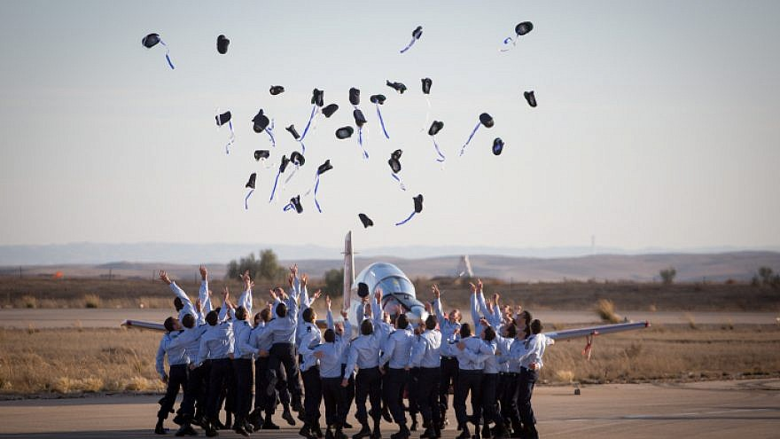 Air Force pilots throw their hats in the air in celebration at a graduation  ceremony for d57c33b5f528d