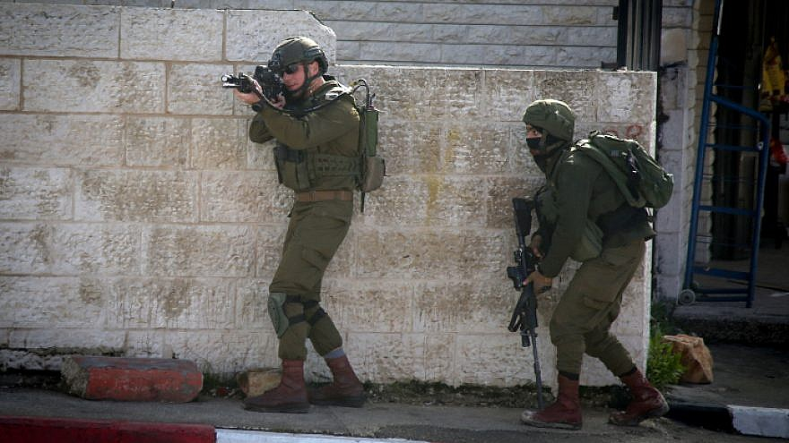 Israeli soldiers conduct a search for Palestinian suspects of a terror  attack in the West Bank a9b389c093858