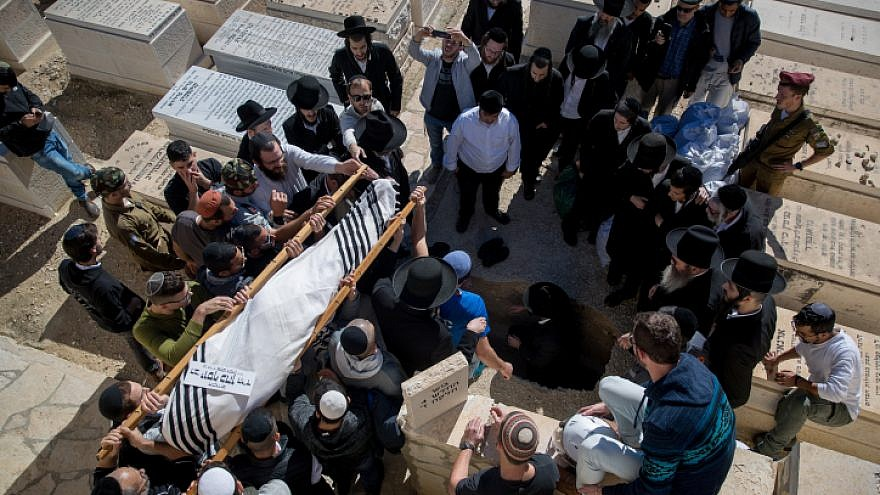 Friends and family members mourn during the funeral of Israeli soldier Yosef Cohen, at the Mount of Olives cemetery in Jerusalem, on Dec. 14, 2018. Cpl. Yosef Cohen and Sgt. Yuval Mor Yosef were killed in a shooting terror attack at the entrance to the Israeli town of Givat Asaf in southern Samaria the day before. Photo by Yonatan Sindel/Flash90.