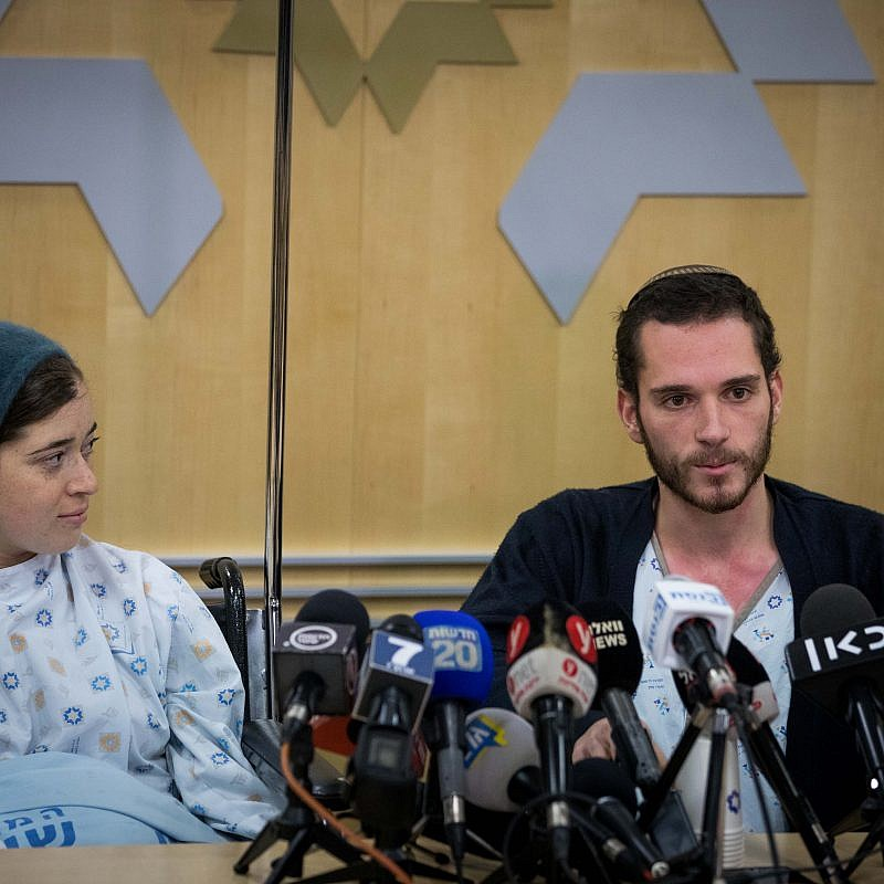 Shira and Amichai Ish-Ran, who were injured in a drive-by shooting on Dec. 9, 2018 when a Palestinian opened fire on Israelis near the settlement of Ofra, answer questions at a press conference at Shaare Zedek Medical Center on Dec. 16, 2018. Shira was 30 weeks pregnant at the time of the attack. Their baby son was delivered by an emergency Caesarean section, but died a few days later. Credit: Yonatan Sindel/Flash90.
