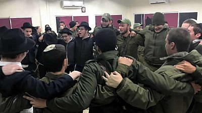 Yeshivah students from Tzfat dance with Israel Defense Forces troops in Metulla prior to an operation in which the troops destroyed a 40-meter-long-tunnel built by the Iranian-backed terror group Hezbollah. The tunnel started in the Lebanese town of Kfarkela and snaked its way into Metulla, an Israeli town of 1,000 surrounded on three sides by Lebanon. Credit: Chabad.org/News.