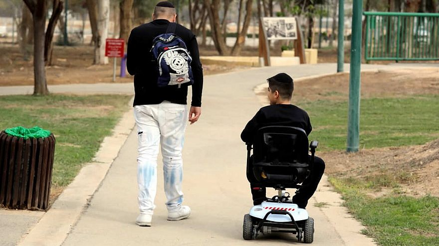 """Enjoying handicap-accessible amenities at Ilanot Forest in central Israel as part of """"International Day of Persons with Disabilities"""" on Dec. 3, 2018. Photo by Diego Mitleberg/KKL-JNF."""