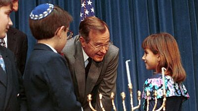 President George H. W. Bush speaks with children at 1991 White House Staff Hanukkah menorah-lighting. Credit: Archives and Records Administration.