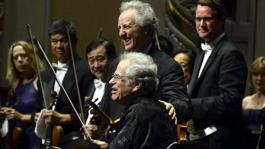 Israeli-American violinist Itzhak Perlman (seated) with music director of the Pittsburgh Symphony Orchestra Manfred Honeck at a Nov. 27, 2018 concert in honor of the 11 Jewish victims of the Tree of Life*Or L'Simcha Synagogue shooting. The concert will be aired nationwide on PBS on Dec. 11, 2018, as well as available afterwards by live-streaming. Credit: Pittsburgh Post-Gazette on http://www.itzhakperlman.com.