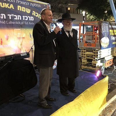Mayor of Tel Aviv-Yafo Ron Huldai inaugurated the renewed Dizengoff Square in Tel Aviv by lighting the fourth Chanukah candle of the central Chabad Chanukah Menorah together with Rabbi Joseph Gerlitzky,