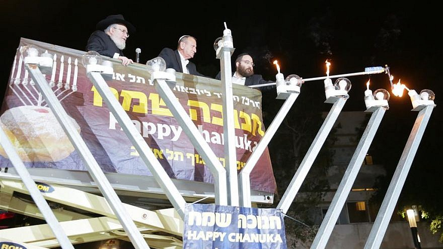 Ron Huldai, the mayor of Tel Aviv-Yafo, inaugurated the renewed Dizengoff Square in Tel Aviv by lighting the fourth Hanukkah candle of the central Chabad menorah, together with Rabbi Joseph Gerlitzky. Dec. 5, 2018.