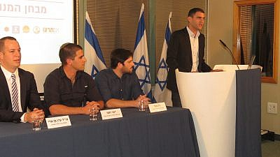 From right to left: Matan Peleg, Gil Bacher, Yishai Hemo, and attorney Eran Ben-Ari. Credit: Tom Nisani.