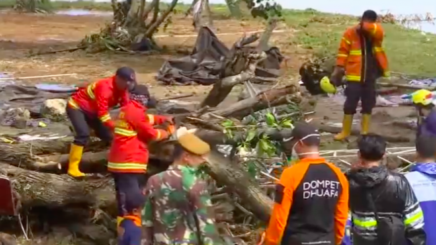 Rescue workers sort through debris in the aftermath of a tsunami that struck Indonesia on Dec. 22, 2018. Credit: Screenshot.