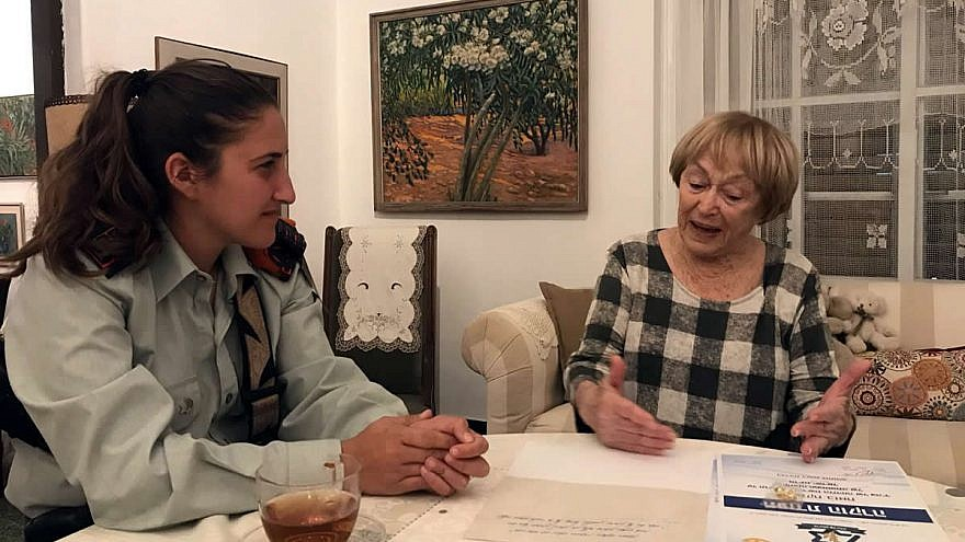 Capt. Ayelet Zion, a 25-year-old Israel Defense Force Company Commander in the Home Front Command Search and Rescue Battalion, with Leah Feldman, who served as a signals operator in the 1948 War of Independence. Credit: IDF.