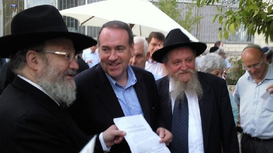 Former Arkansas Gov. Mike Huckabee with RCP leaders Rabbis Joseph Gerlitzky and Avraham S. Lewin.