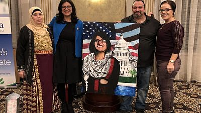 Executive director of the Palestine Right to Return Coalition Abbas Hamideh poses with Rep. Rashida Tlaib (D-Mich.) at a swearing-in ceremony and private dinner in Detroit on Jan. 12, 2019. Credit: Abbas Hamideh/Twitter.