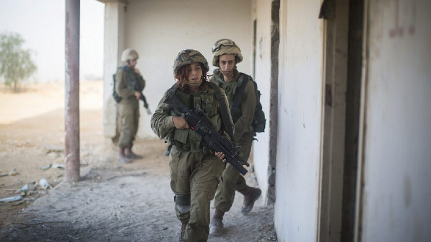 Soldiers of the Bardales Battalion train in urban warfare on a foggy morning near Nitzanim in southern Israel, on July 13, 2016. Formed in 2014, the Bardales Battalion is an infantry combat battalion of the Israel Defense Forces composed of 50 percent female soldiers and assigned for future routine security along the Jordanian border in central Israel. Photo by Hadas Parush/Flash90.