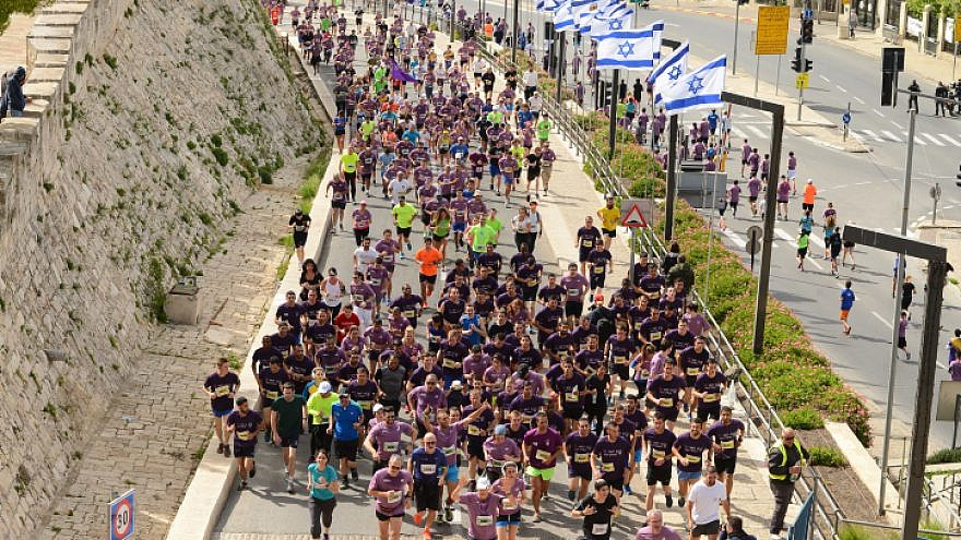 Thousands of runners take part in the 2018 international Jerusalem Marathon in Jaffa Gate in Jerusalem Old City on March 9, 2018. Photo by Mendy Hechtman/Flash90.