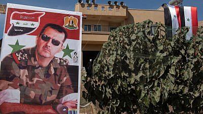 A poster of Syrian dictator Bashar al-Assad. October 06, 2018. Credit: Basel Awidat/FLASH90