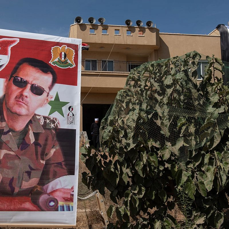 A poster of Syrian President Bashar Assad. Oct. 6, 2018. Credit: Basel Awidat/Flash90.