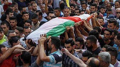 Palestinians carry the body of 48-year-old mother of eight Aisha Rabi, who died of her wounds after the car she was traveling in with her husband was hit by stones, during her funeral in the West Bank village of Bidya on Oct. 13, 2018. Credit: Nasser Ishtayeh/Flash90.