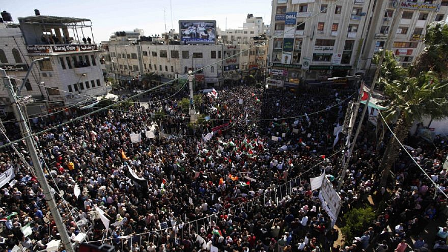 Thousands of Palestinians in Ramallah protest against a social security law established by the Palestinian Authority that has them concerned over the distribution of funds, Oct. 29, 2018. Photo by Nasser Ishtayeh/Flash90.