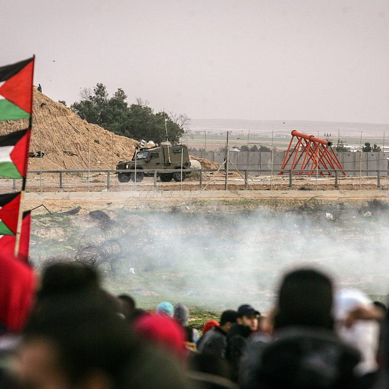 "Palestinian protesters clash with Israeli troops during the weekly ""March of Return"" protests on the Israeli-Gaza border, Dec. 7, 2018. Credit: Abed Rahim Khatib/Flash90."