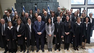 Israeli Justice Minister Ayelet Shaked , President Reuven Rivlin , Supreme Court President Esther Hayut poses for a picture with newly sweard in judges at the President's Residence in Jerusalem, on Jan. 8, 2019. Photo by Noam Revkin Fenton/Flash90.