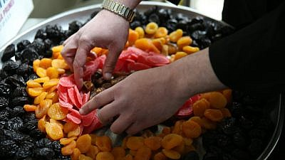 Dried fruits are prepared for a Tu B'Shevat holiday celebration in Meron, in northern Israel, on Jan. 20, 2019. Photo by David Cohen/Flash90.