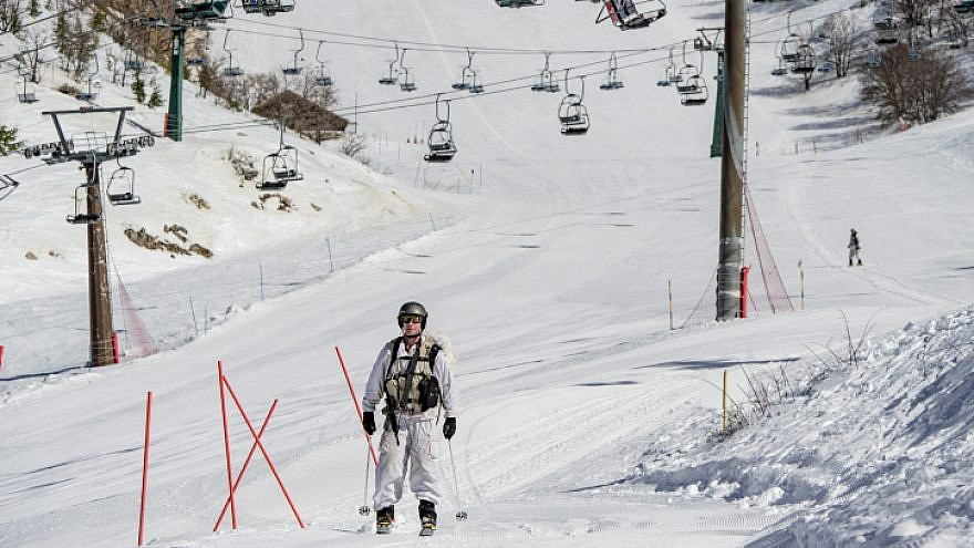 An Israeli soldier skis on snow-covered Mount Hermon in the Golan Heights in northern Israel on Jan. 21, 2019. Photo by Basel Awidat/Flash90.