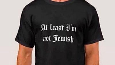 "A T-shirt reading ""At Least I'm Not Jewish"" taken off from Zazzle.com. Credit: Screenshot."