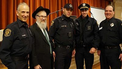 Four Pittsburgh police officers who were injured while responding to the Oct. 27 shooting during Shabbat-morning services stand with Rabbi Yisroel Rosenfeld, director of Chabad Lubavitch of Pittsburgh. (Photo: Yeshiva Schools of Pittsburgh)