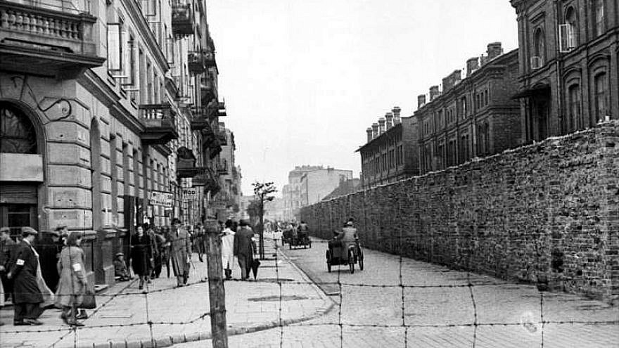 The view on Grzybowska Street from the gate at Żelazna Street, looking eat from the Polish side into the Warsaw ghetto, June 1942. Credit: German Federal Archives.
