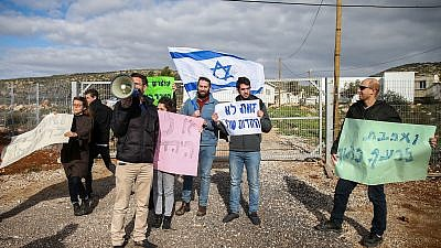 Israelis protest at the entrance to the Israeli settlement of Rehelim against the Jewish youth suspected in the killing of a Palestinian woman last year, Jan. 8, 2019. Photo by Ofer Meir/Flash90.