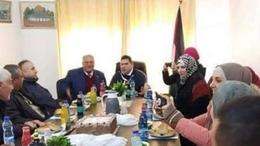 Palestinian Authority leaders discuss boycotting Israeli products at a meeting where Israeli orange drinks are served. Credit: Amad independent Palestinian news website, Jan. 22, 2019, (PMW)
