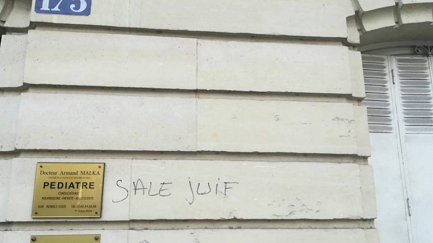 """Dirty Jew"" was tagged on a building in the 14th arrondissement (district) of Paris. Credit: European Jewish Press."