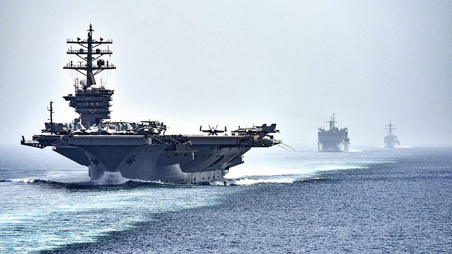 "The aircraft carrier ""USS Dwight D. Eisenhower"" (CVN 69), followed by the fast combat support ship ""USNS Arctic"" (T-AOE 8) and the guided-missile destroyer ""USS Nitze"" (DDG 94), transit the Strait of Hormuz. The Eisenhower Carrier Strike Group is deployed in support of maritime security operations and theater security cooperation efforts in the U.S. 5th Fleet are of operations. Credit: Mass Communication Specialist 3rd Class J. Alexander Delgado/U.S. Navy."