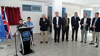 Minister of State for International Development MP Alan Duncan (left) looks on as students deliver a presentation at the opening of a United Kingdom-funded elementary school in Gaza in 2013. Credit: UNRWA/Flickr.