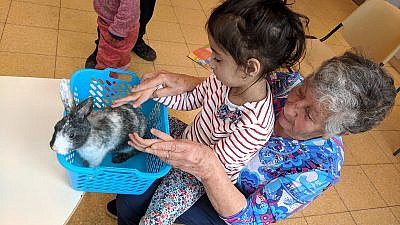 """Known as """"Super Savta,"""" Dr. Violet Esser, a retired dentist from Toronto, spends two weeks every winter volunteering at ALEH's special-education school in the Negev. Credit: ALEH."""