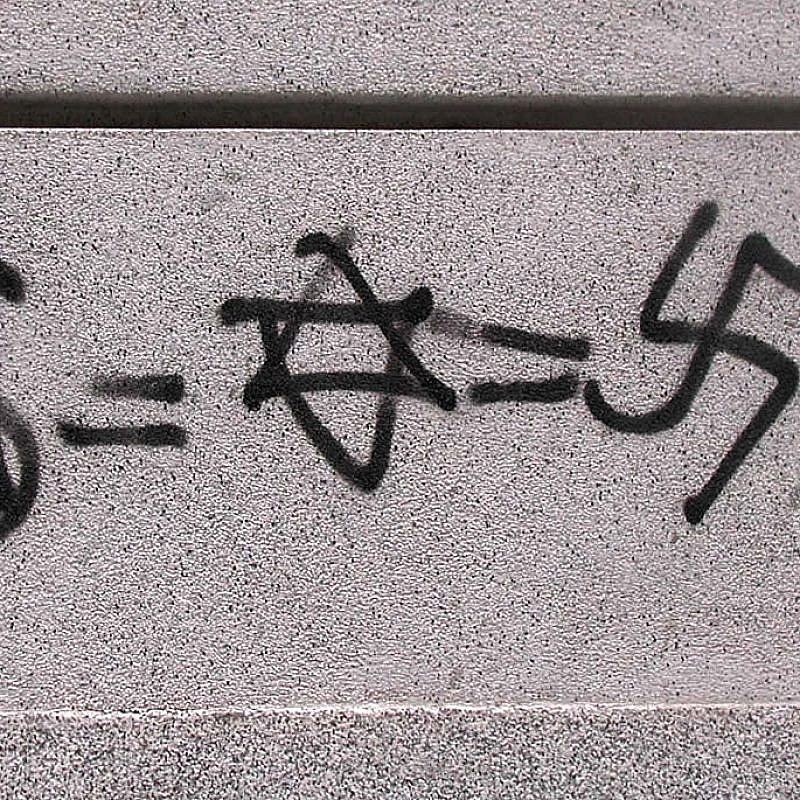 Antisemitic graffiti equating Judaism with Nazism and money, found in Madrid in 2003. Credit: Wikimedia Commons.