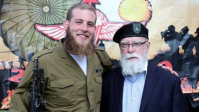 Col. Rabbi Jacob Goldstein, former chief chaplain of the New York Army National Guard, with his grandson, Joe Brickman of Brooklyn, N.Y., who received his red beret from the haredi paratrooper company Chetz on Feb. 21, 2019. Photo by Revah Hafakot.