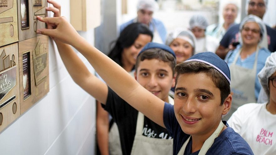 Pantry Packers is one charity associated with a new online initiative that fosters giving tzedakah on a daily basis. Credit: DailyGiving.org.