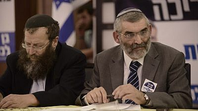 Former Israeli Knesset member and leader of the Otzma Yehudit Party Michael Ben-Ari (right) seen with  Baruch Marzel at the party's inaugural election conference in Petach Tikvah, on Dec. 24, 2014. Photo by Tomer Neuberg/Flash90.