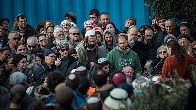 Friends and family members attend the funeral of 19-year-old Ori Ansbacher in the Jewish settlement of Tekoa on Feb. 8, 2019. The young woman was found dead last night in Ein Yael, in the outskirts of Jerusalem, in what police are suspecting is a rape and murder. Credit: Yonatan Sindel/Flash90.