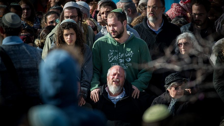 Friends and family members attend the funeral of Ori Ansbacher, 19, in the Jewish settlement of Tekoa on Feb. 8, 2019. The young woman was found dead the day before in Ein Yael, in the outskirts of Jerusalem, in what police declared a rape and murder. Photo Yonatan Sindel/Flash90.
