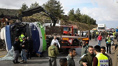 Israeli rescue forces and security forces at the scene of a car accident between a bus and a minivan on Road 433 near Modi'in on Feb. 10, 2019. Photo by Noam Revkin Fenton/Flash90.