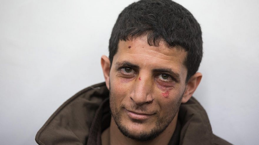 Arafat Irfaiya, 29, was charged with the murder of 19-year-old Ori Ansbacher on Feb. 11, 2019. He was captured in Ramallah after Israeli security forces investigated the scene where the young woman was found raped and dead on Feb. 7 on the outskirts of Jerusalem. Photo Yonatan Sindel/Flash90.